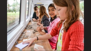 Children engaging on board the vessel. image ikon-gallery.org