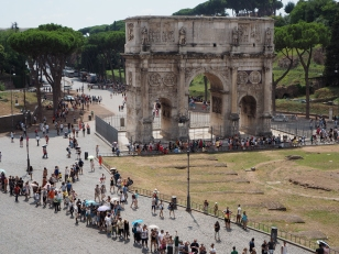 Crowds queueing to enter the Colosseum in Rome. 12 Euro tickets are valid for 2 days for visitors to explore, The Palatine Hill, The Forum and The Colosseum itself plus 3 onsite museums.